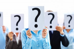 854236-business-people-with-question-mark-on-boards